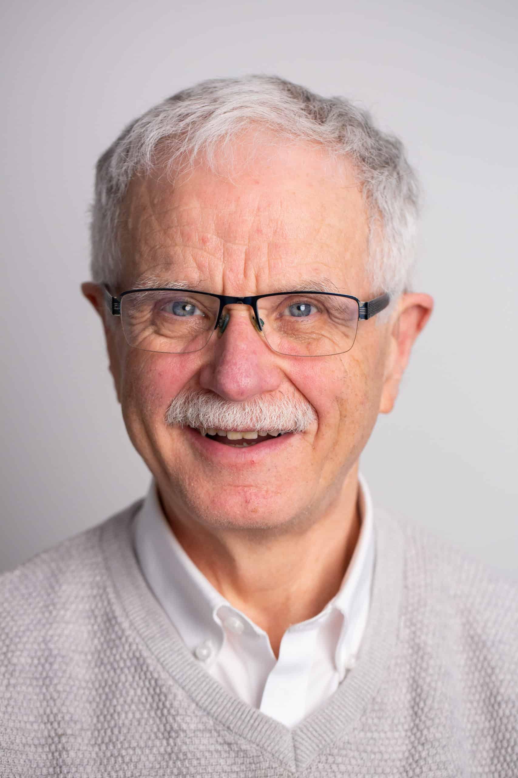 Headshot of Martin MacKinnon - CFO